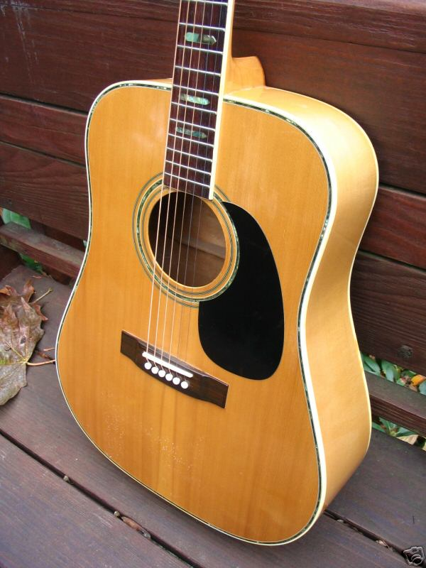 Cortley C75 Spruce Top with Abalone around edge and Sound Hole